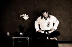 Martial arts master rests in his dojo.