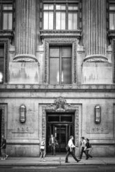 Location, Midtown Manhattan - I love the massive columns and the small doorway between them. I shot this several times before I found just the right combination of people interacting with the building. The strength here is geometry and scale.